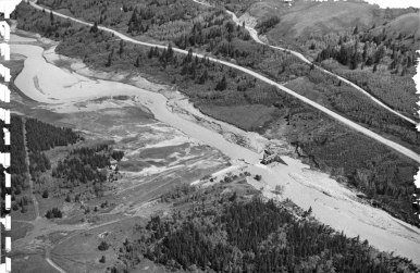 During the June 1964 floods, the Blackfeet Indian Irrigation Project suffered disastrous damage and loss, the most important of which was Lower Two Medicine Lake Dam on Two Medicine Creek. Bureau of Reclamation photograph.