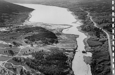 Aerial view showing all that remained of the Lower Two Medicine Lake Dam after the June 1964 floods, the control section and spillway. Bureau of Reclamation photograph.